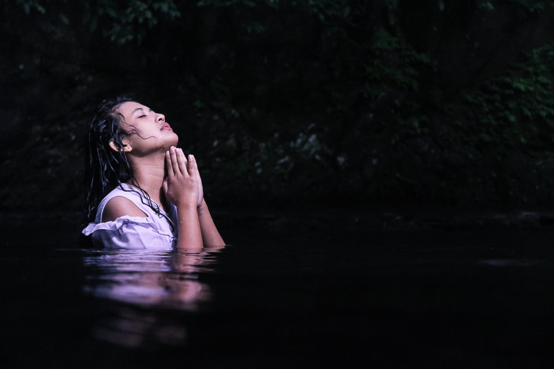 photography of a woman on water