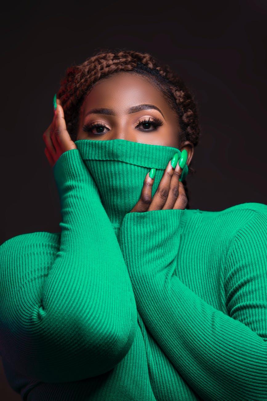 woman wearing green rib turtleneck sweater